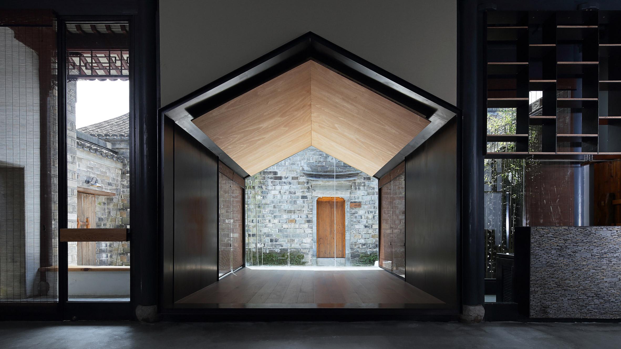 Glazed Meditation Room Overlooks Traditional Courtyard