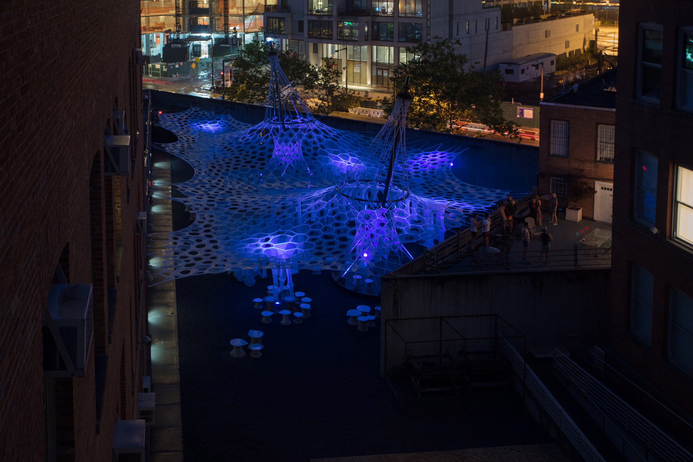 Jenny Sabin stretches robotically woven canopy across MoMA PS1 courtyard