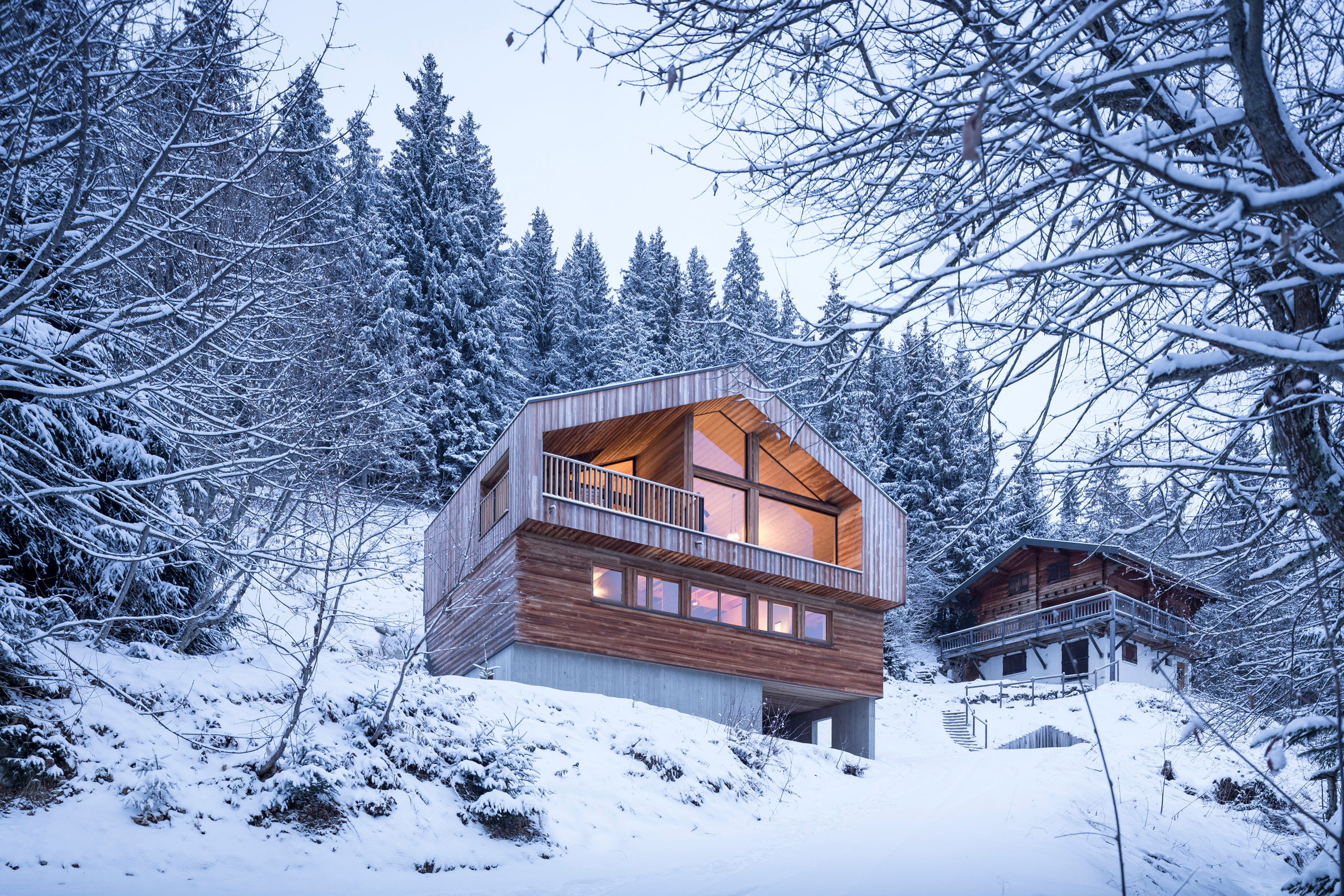 Studio razavi reinterprets traditional chalet architecture for Alpes archi