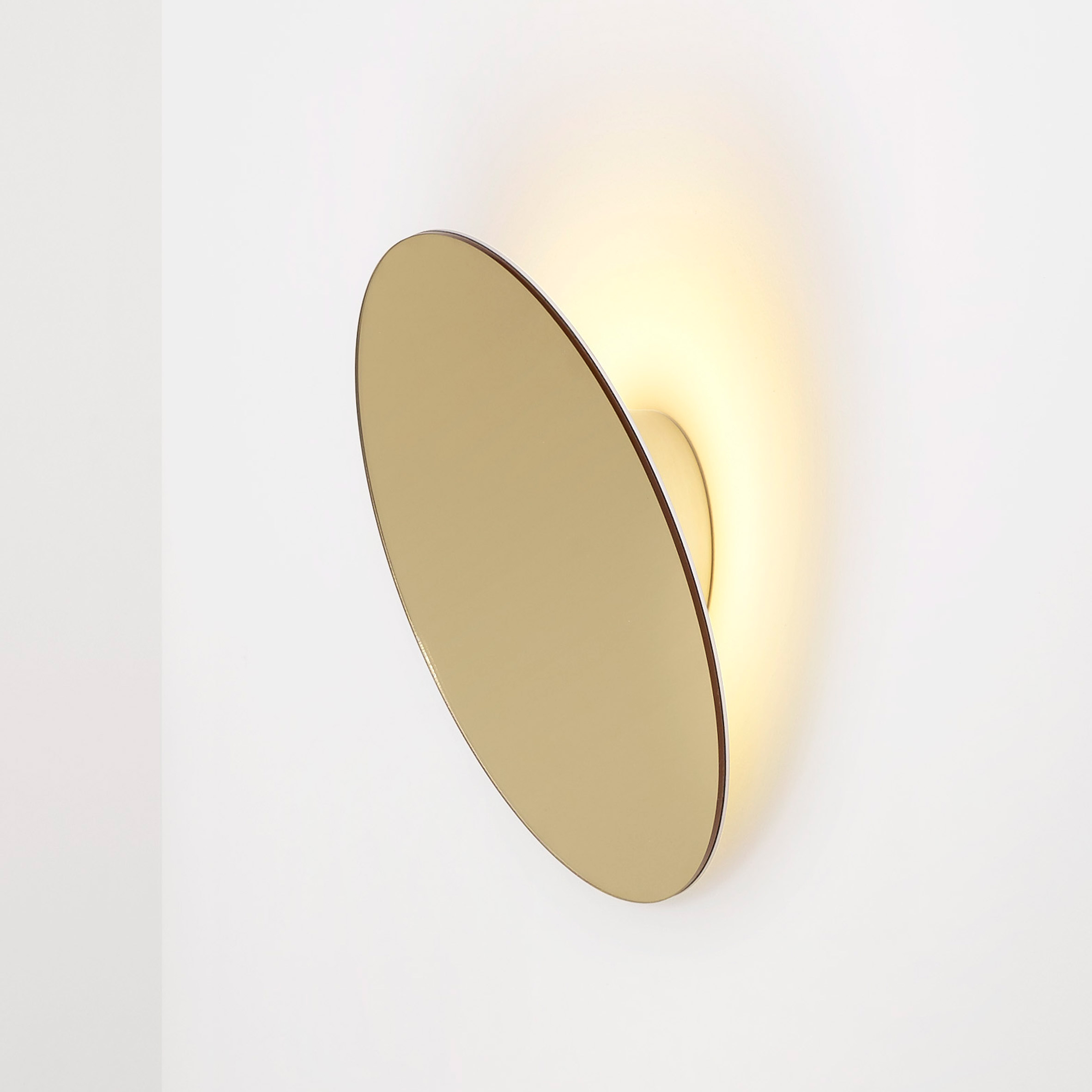 Ross Gardam's Polar wall lamp pivots to create rings of light