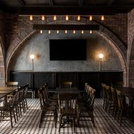 Salón Sociedad bar brings together corporate employees in dark, cosy interior