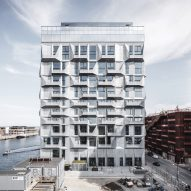 COBE transforms Copenhagen grain silo into apartment block with faceted facades