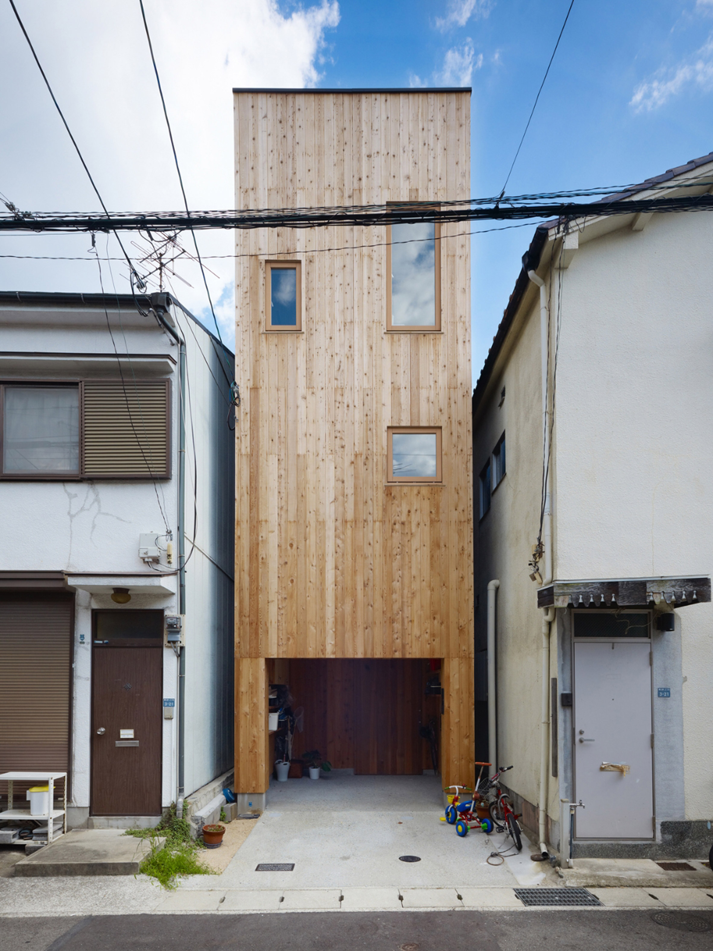 Skylights and slatted floors bring daylight into 2.5-metre-wide house in Japan