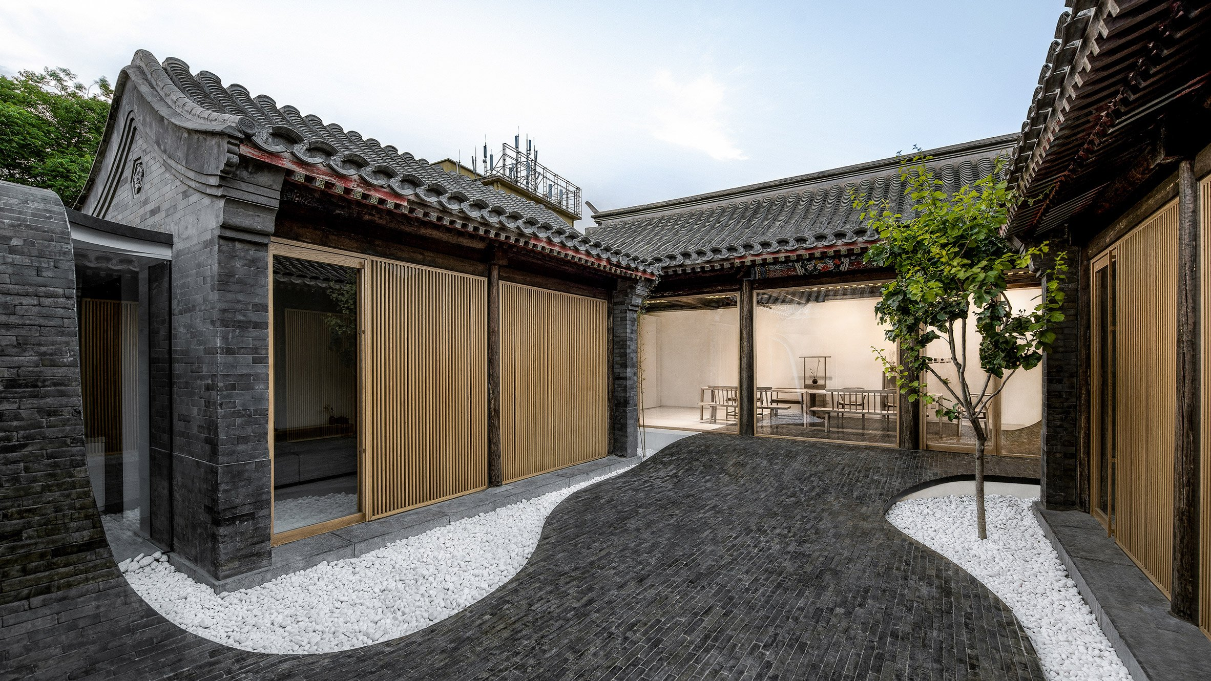 undulating paving connects inside and outside spaces at twisting undulating paving connects inside and outside spaces at twisting courtyard house