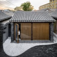 Undulating paving connects inside and outside spaces at Twisting Courtyard house