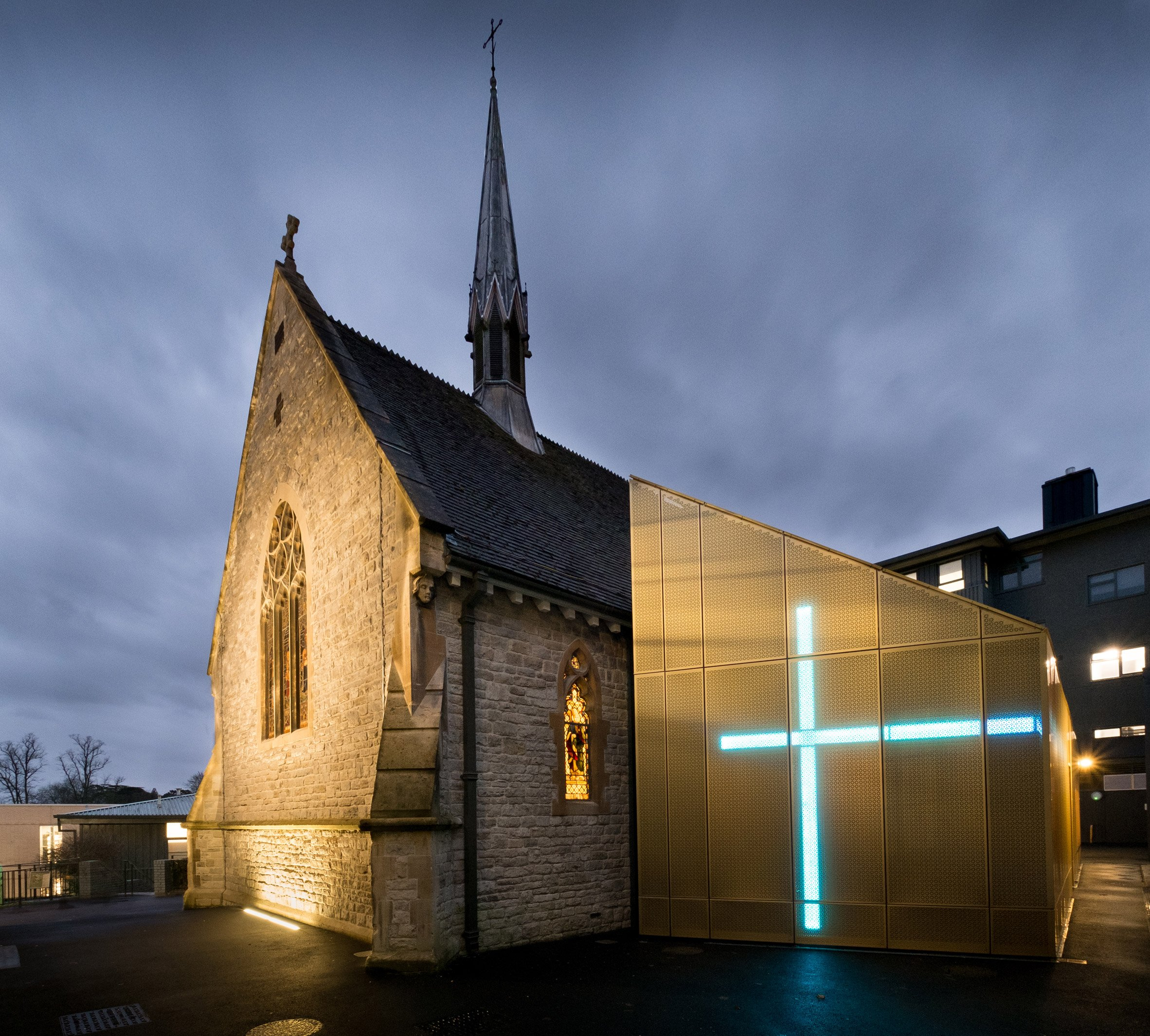 Glowing gold extension added to Winchester university chapel by Design Engine