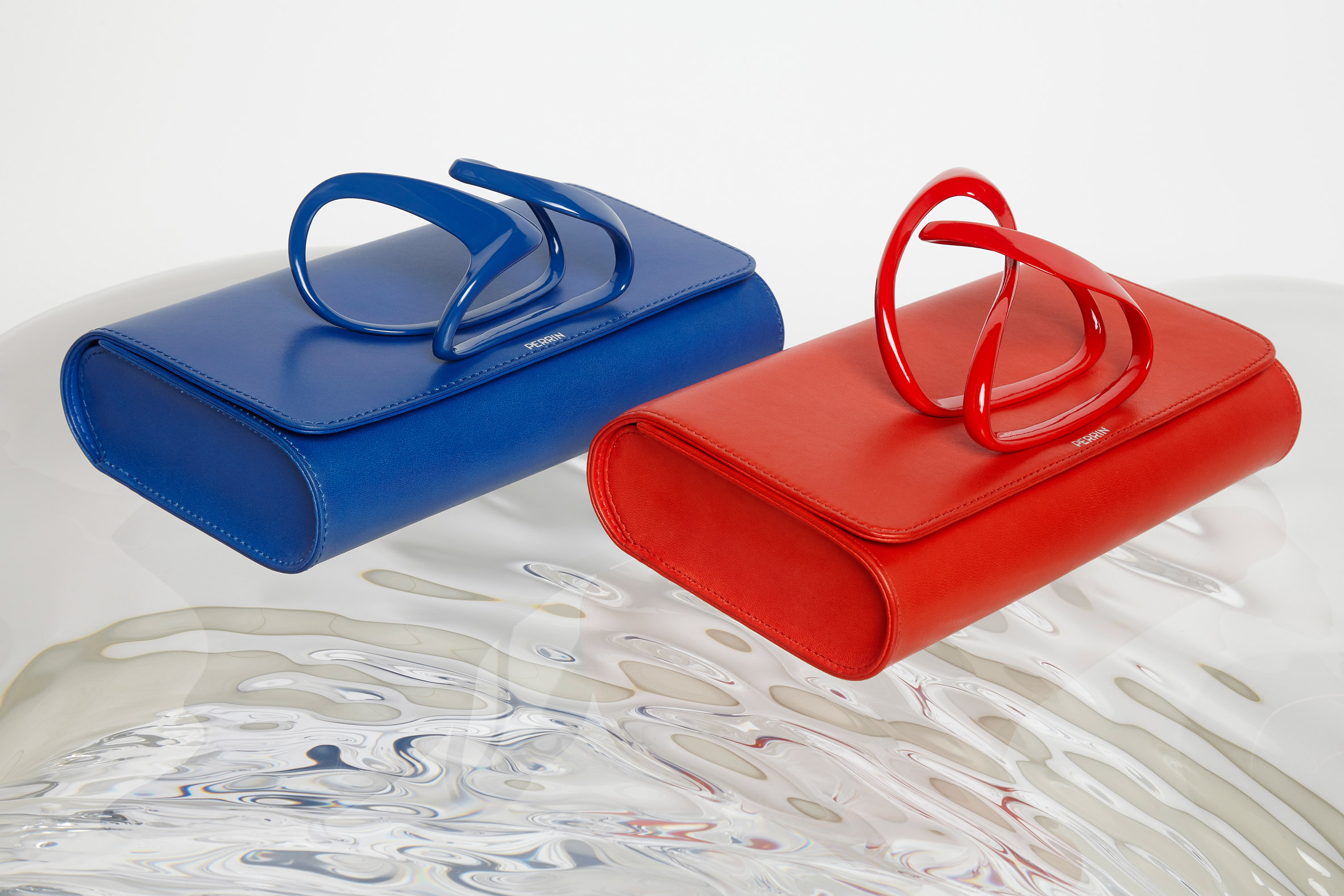 Zaha Hadid Design collaborates with Perrin Paris for range of cuffed clutch bags