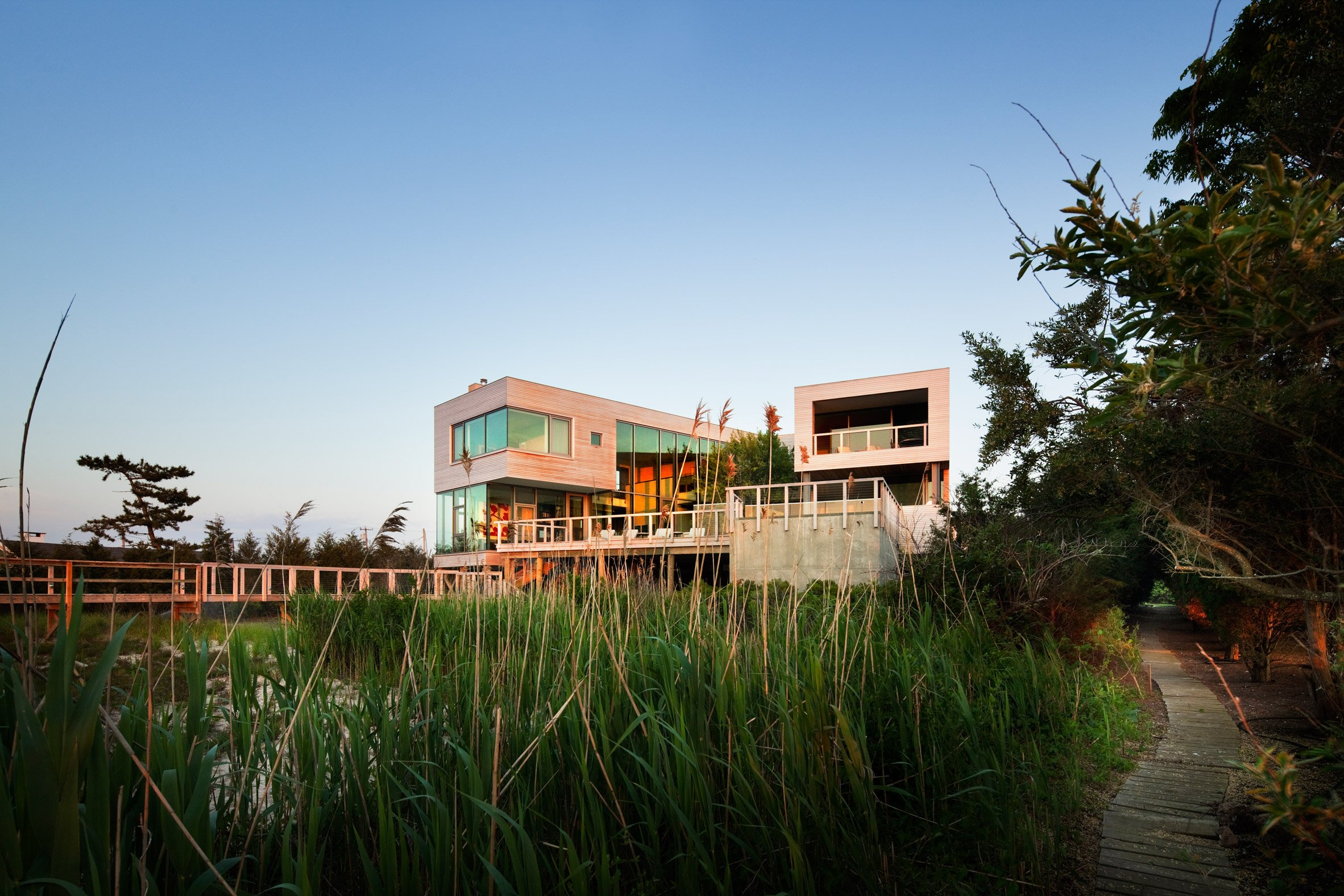 Leroy Street Studio lifts Hamptons house above the water on stilts