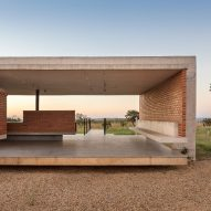 Concrete ribs cradle brickwork walls at Bloco Arquitetos' Brasília residence