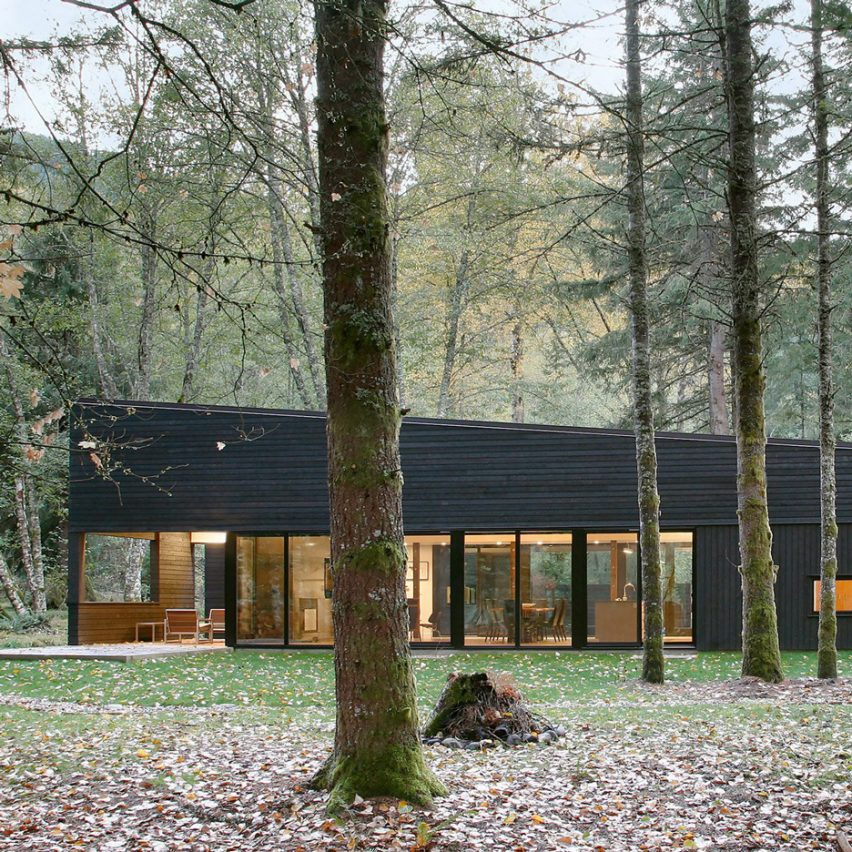 blackened wood house by robert hutchison provides retreat