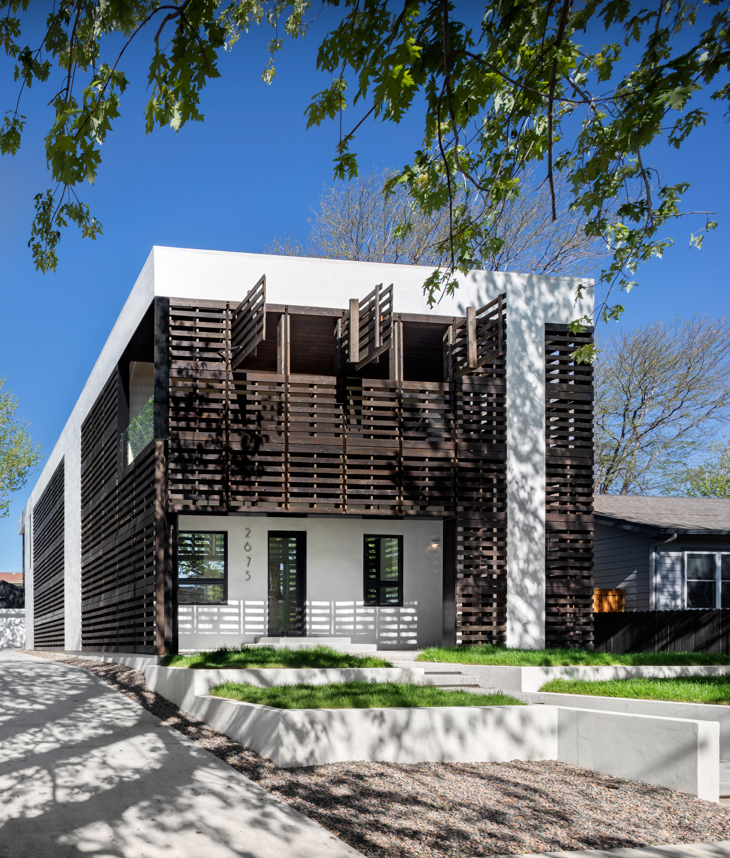 Meridian 105′s Denver house features screens and shutters made of black wooden pallets