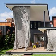 Woven metal-mesh curtain wraps Melbourne house extension designed by Matt Gibson
