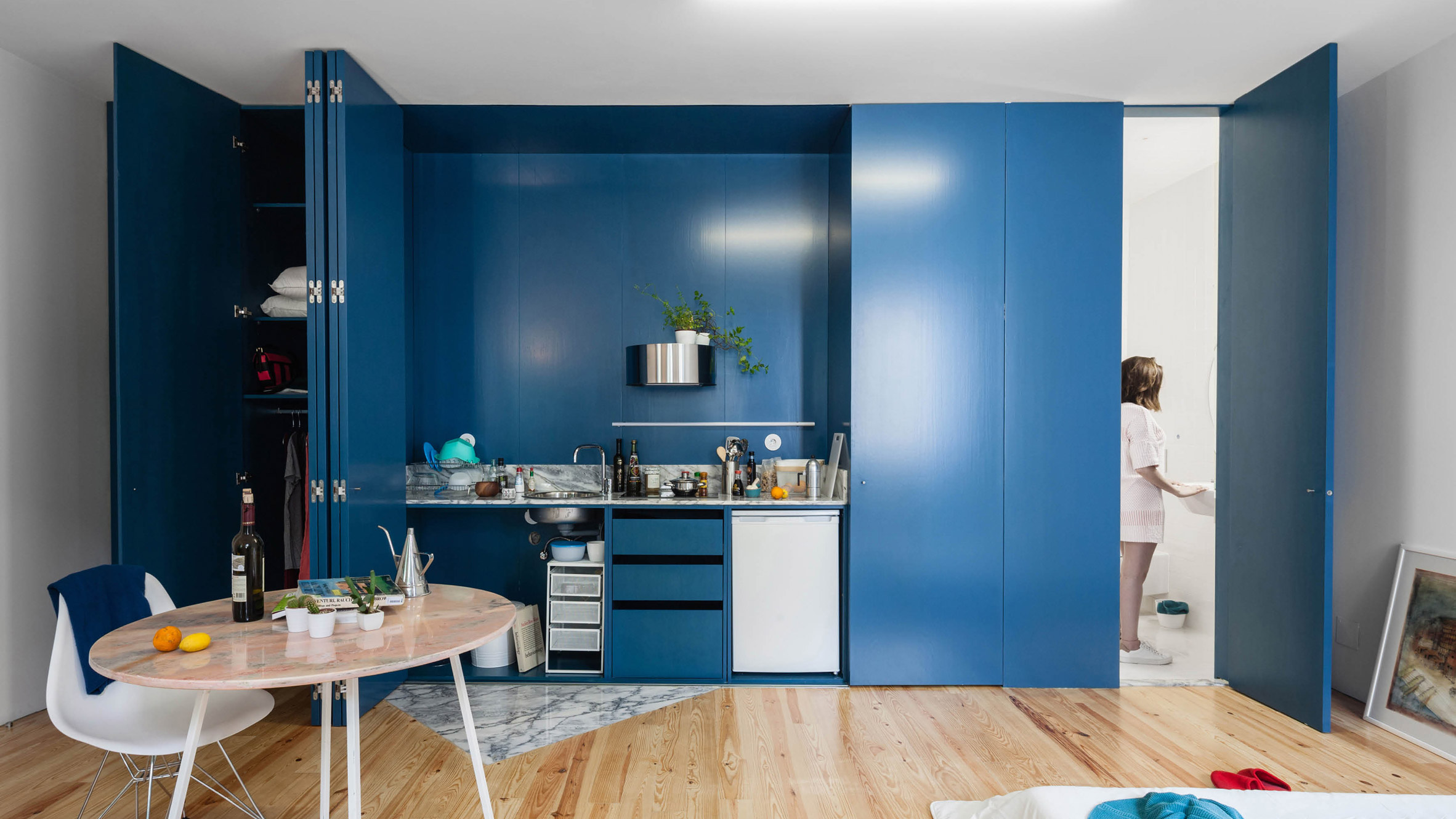 Blue shutters conceal kitchens and windows in Porto flats by Fala ...