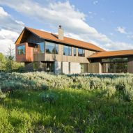 Dynia completes house facing a Wyoming mountain range