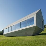 Drawbridge and sliding walls can close off house by Robert Konieczny