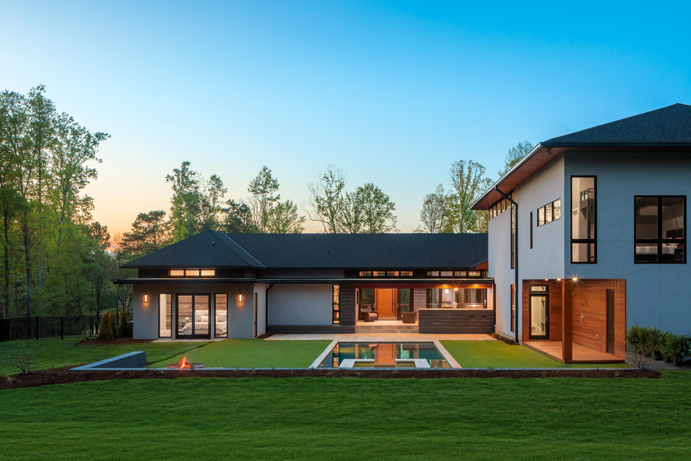 Grey brick, stucco and warm timber wrap South Carolina home by Marica McKeel