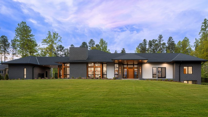 Grey brick stucco and warm timber wrap south carolina home by marica mckeel