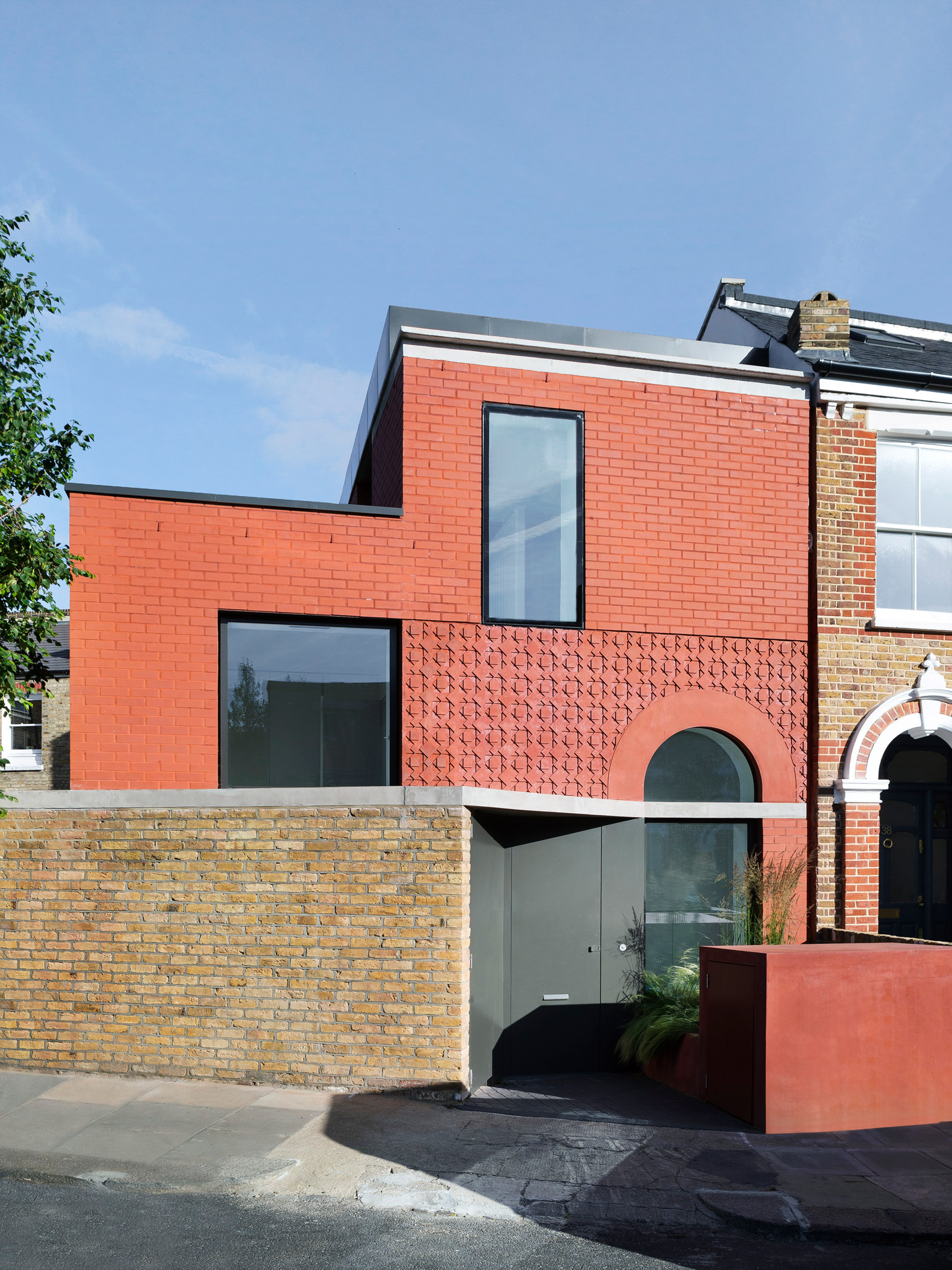 31 44 architects adds contemporary red brick house to for Modern house details