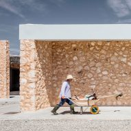 Munarq Arquitectes uses sandstone, cork, ceramic bricks and wicker to build solar-powered winery in Majorca