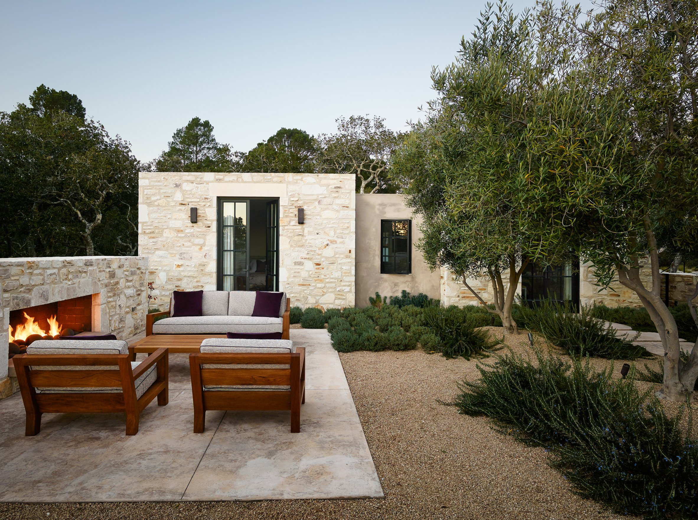 Studio Schicketanz creates California home with glass and textured stone walls