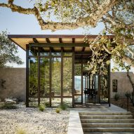 Studio Schicketanz creates home with glass and stone walls in Clint Eastwood's California golf resort