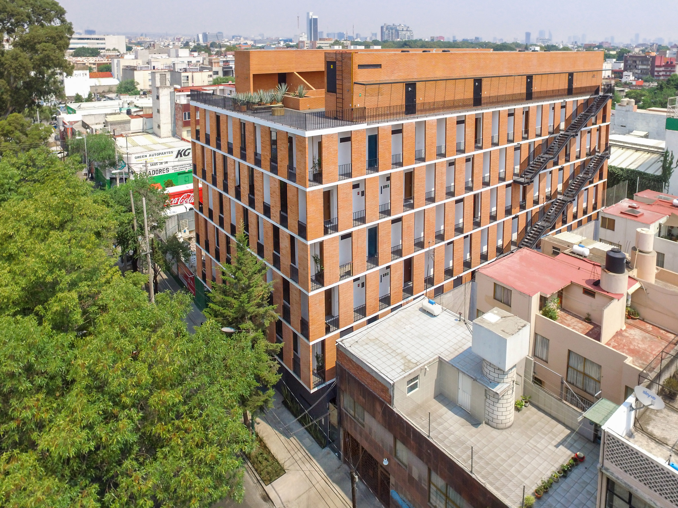HGR Arquitectos uses orange bricks to build Mexico City apartment block