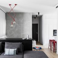 Yael Perry includes flashes of colour in otherwise muted apartment in Israel