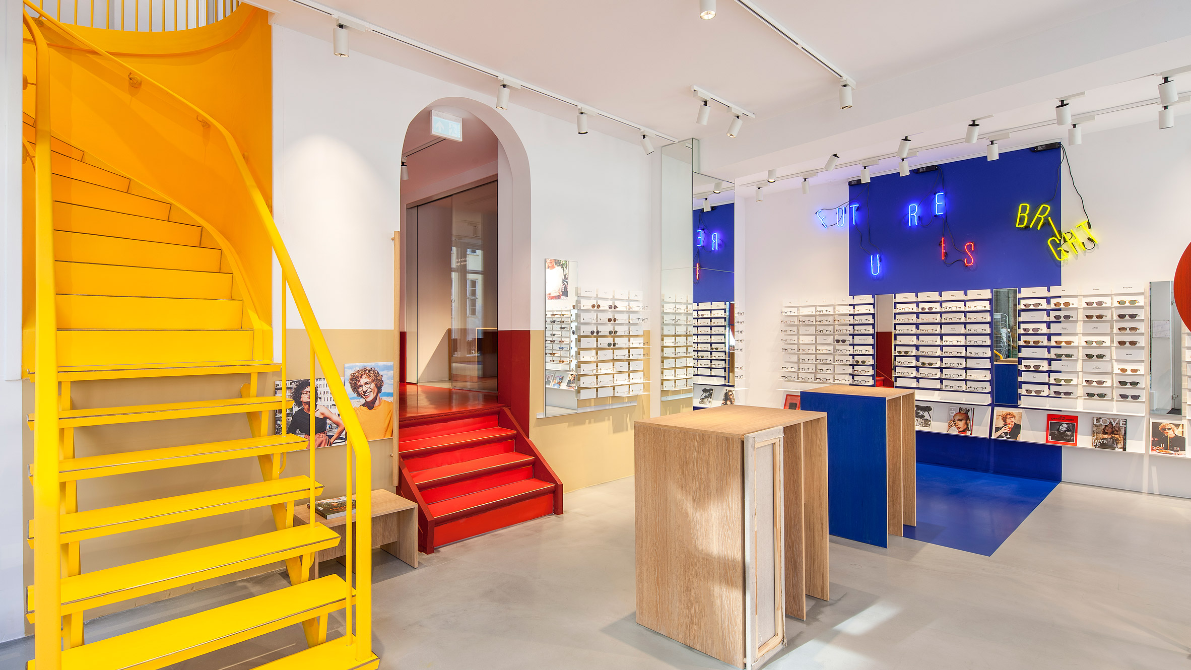 shop architecture and interior design dezeen ace tate s copenhagen eyewear store features blocks of primary colours