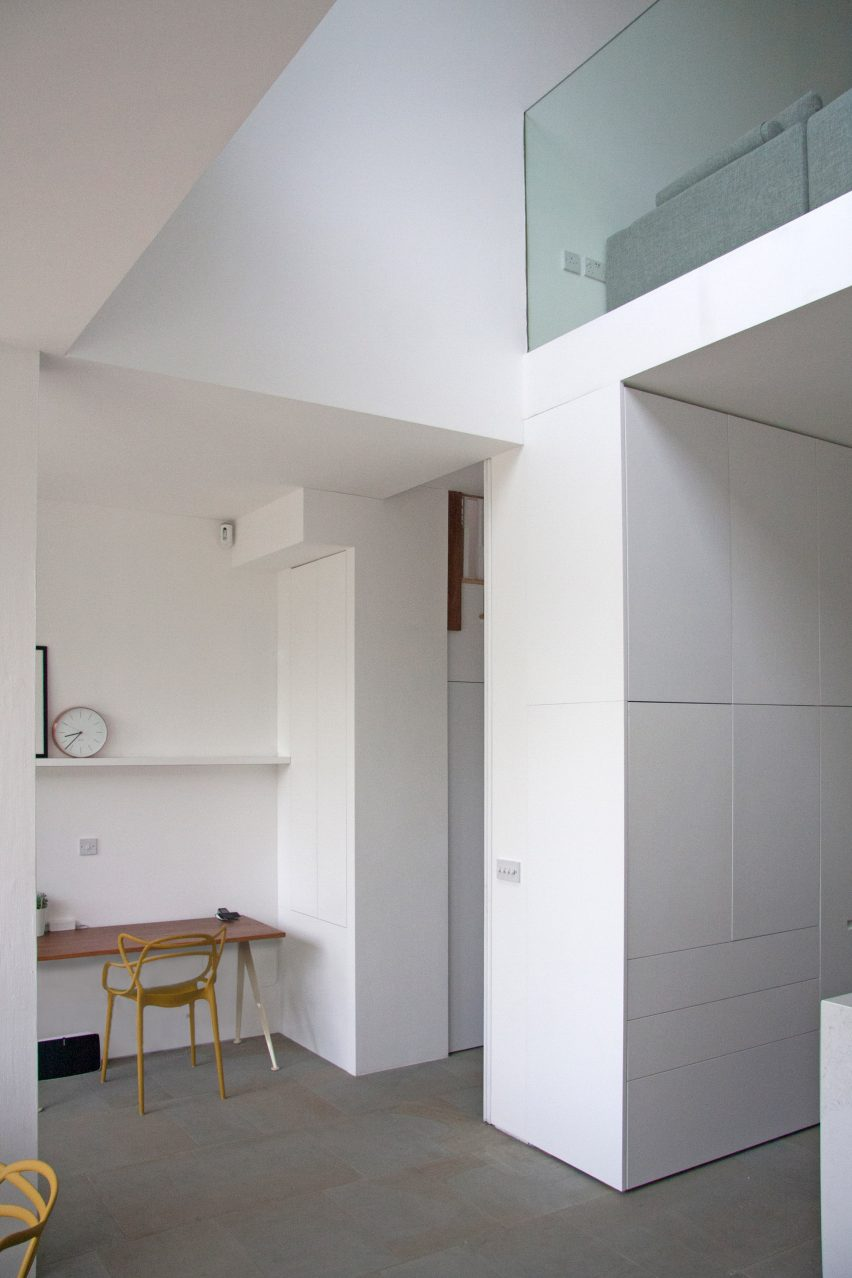 Shelving units and concealed doors compartmentalise London home