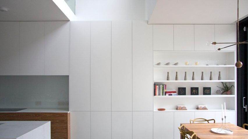 Shelving units and concealed doors compartmentalise refurbished London home