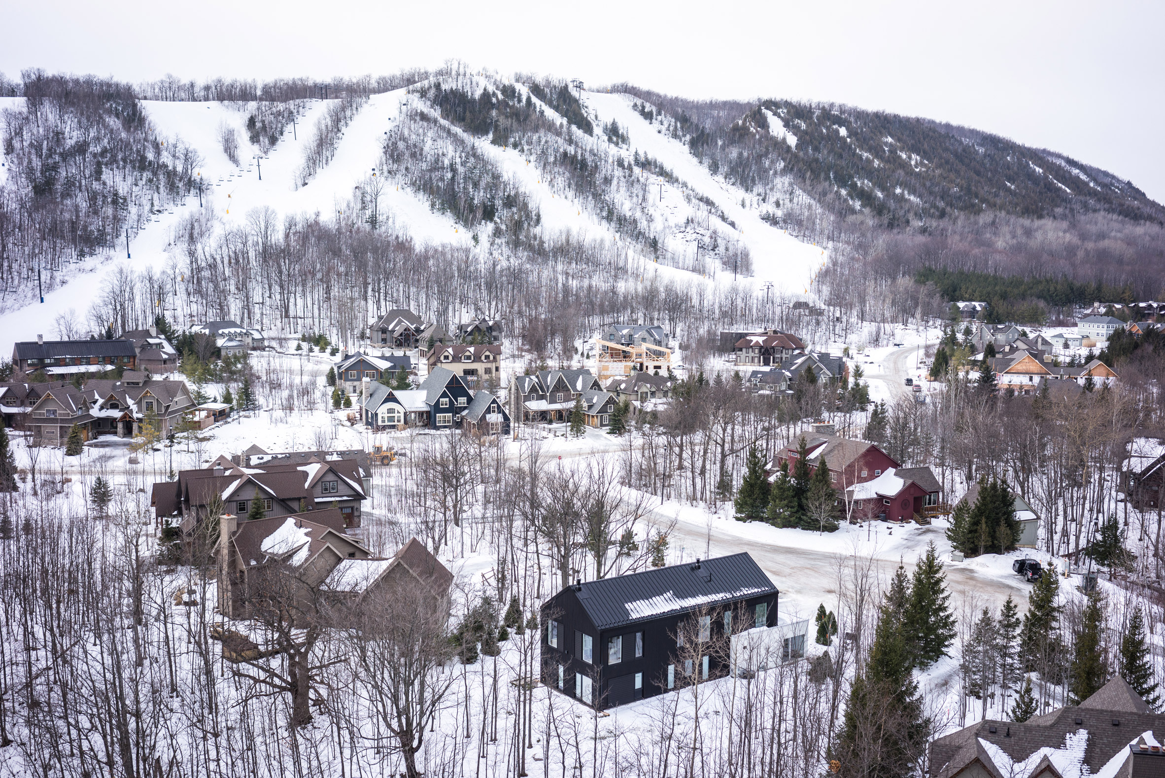 Monochrome Canadian ski lodge by Atelier Kastelic Buffey echoes traditional farmhouses