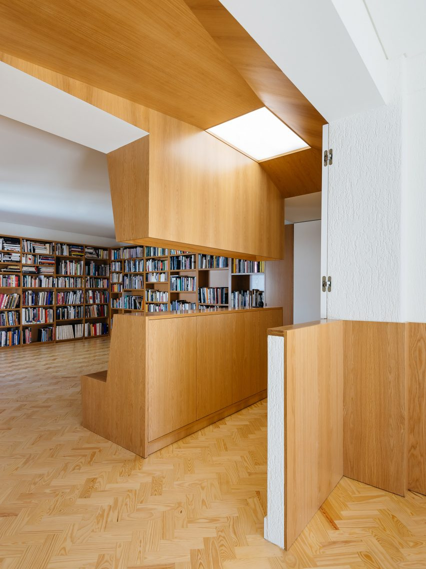 skylights and folding walls update 1970s lisbon apartment
