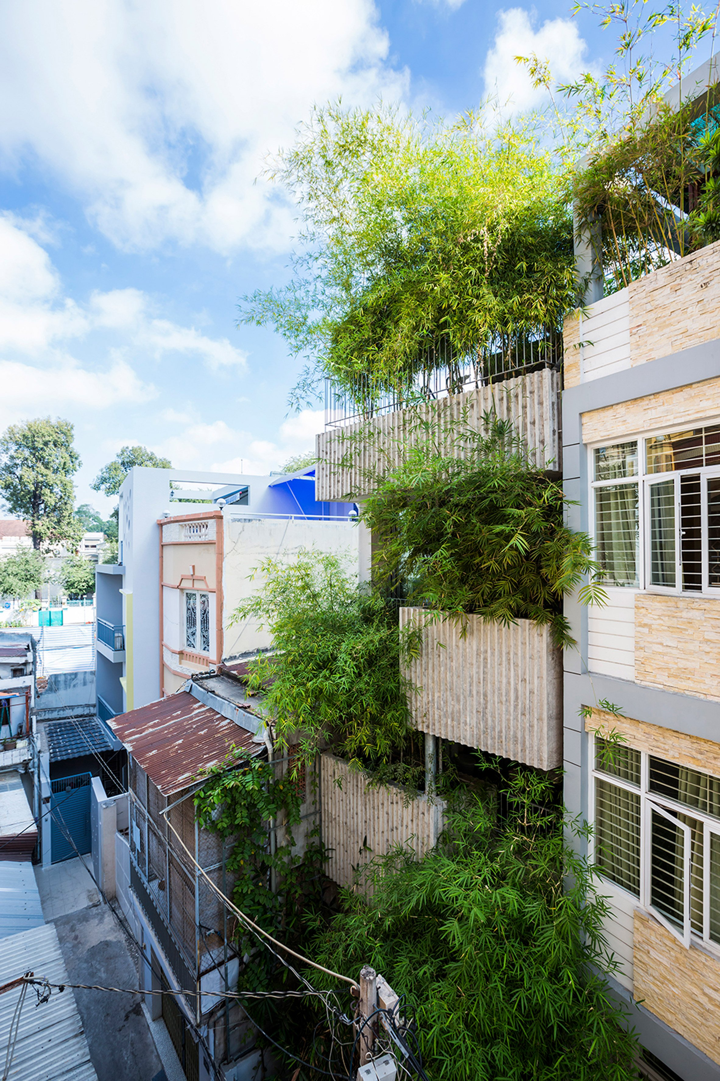 Vo Trong Nghia fronts slim house in Ho Chi Minh City with huge bamboo-filled planters