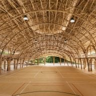 "Arched bamboo trusses left exposed in Chiang Mai sports hall to create a ""feast to the eye"""