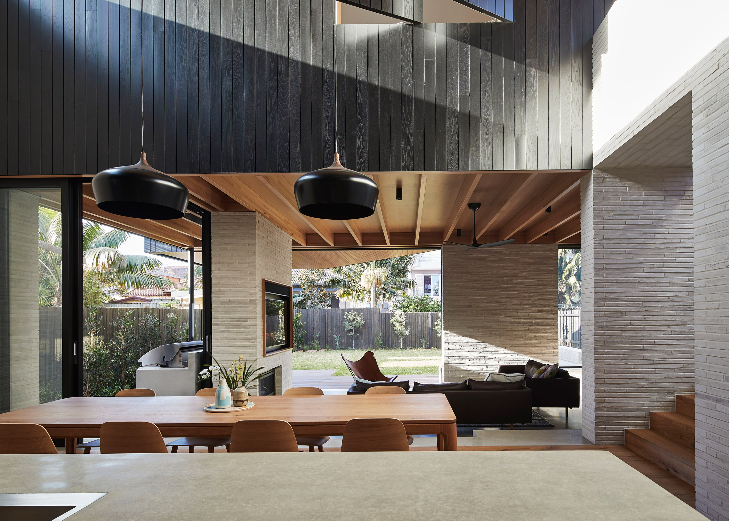 Andrew Burges' Sydney house pairs pale brickwork with blackened wood