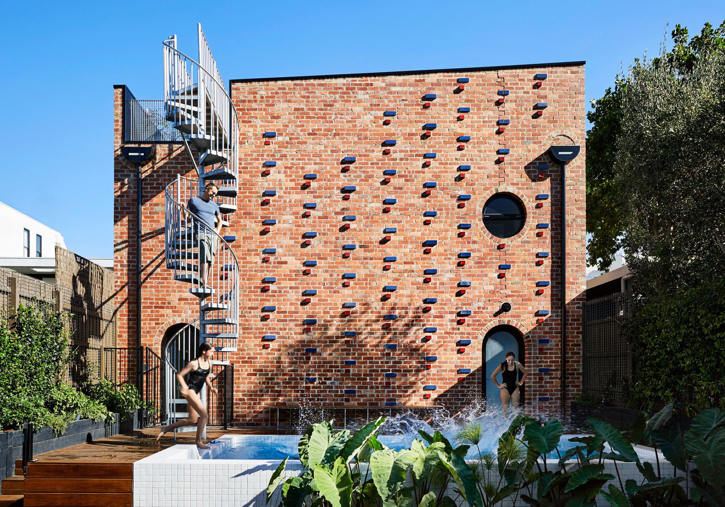 Austin Maynard Architects builds recycled brick house on top of former Melbourne garage
