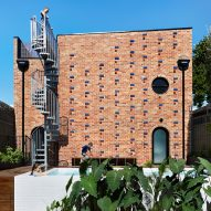 Austin Maynard Architects builds recycled-brick house on top of former Melbourne garage