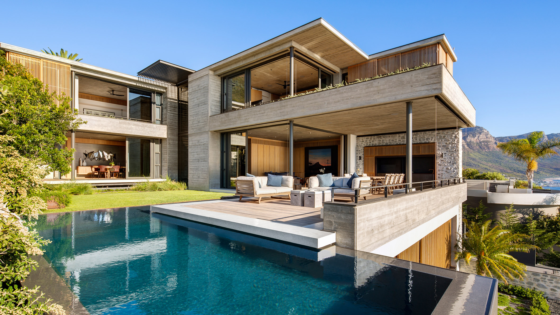 sliding glass walls allow sea breezes into malan vorster s clifton house