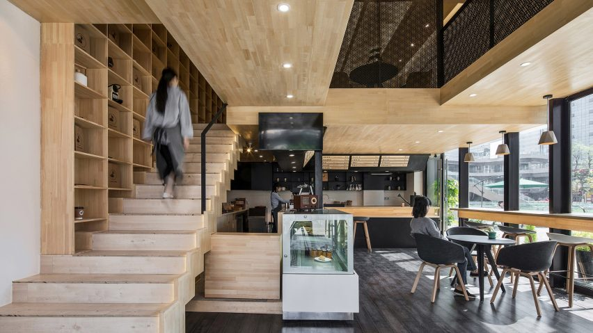Chengdu coffee shop features a staircase that extends out of a bookcase malvernweather Gallery