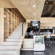 Chengdu coffee shop features a staircase that extends out of a bookcase