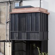 Scullion Architects adds charred-larch tower to terraced home in Dublin