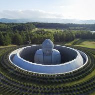 Tadao Ando surrounds huge buddha statue with lavender-covered mound at Sapporo cemetery
