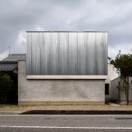 Kouichi Kimura completes steel-wrapped home and studio for photographer in Shiga