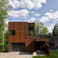 Canadian lake house by Paul Bernier features dark wood and rusted metal cladding