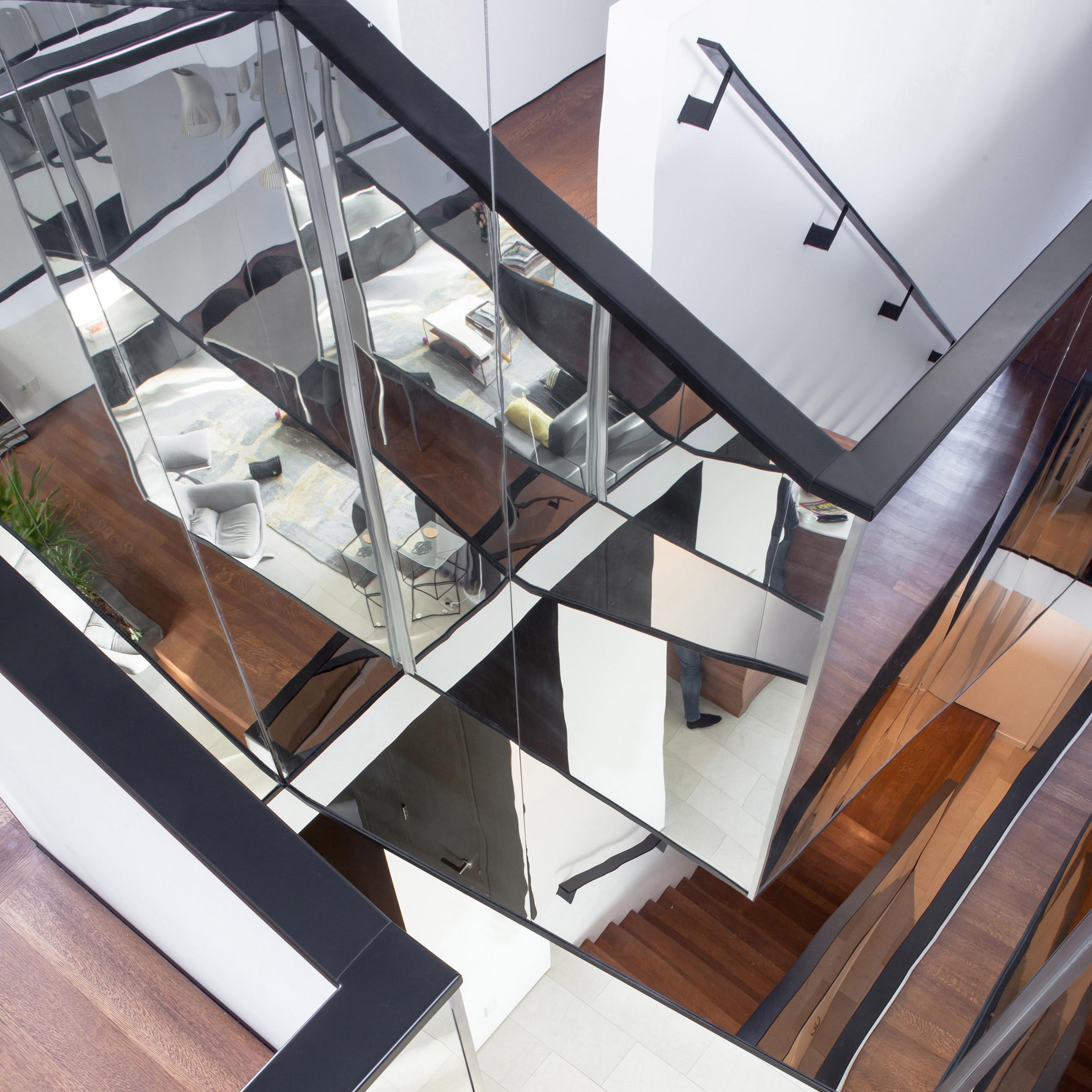 mirrored staircase features in kaleidoscope housepaul raff studio