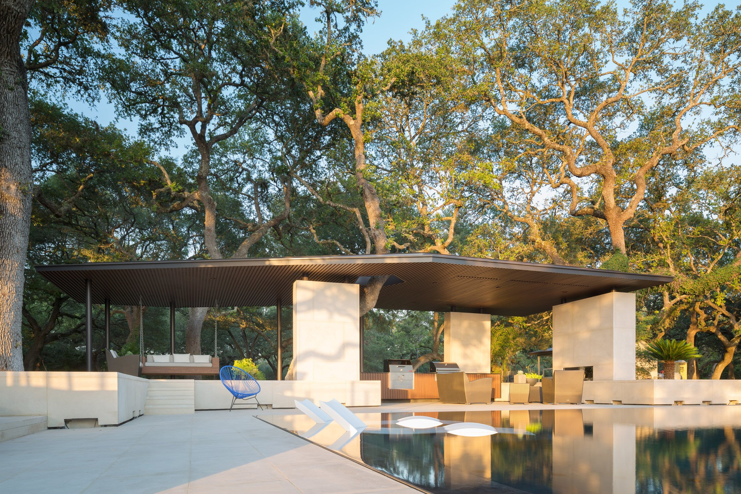 Murray Legge's Texas pool house avoids and incorporates tree trunks
