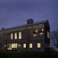 Lights glow through slatted teak facades of Hamptons home by Leroy Street Studio