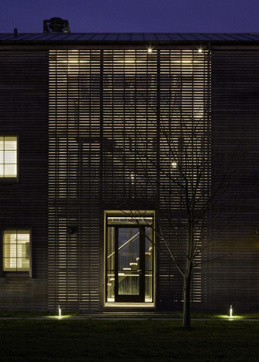 lights glow through facades of hamptons homeleroy street studio