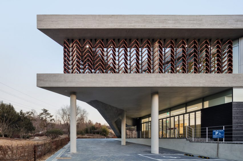 Seoul architecture studio Soft Architecture Lab designed the Wood Culture Museum for a site in Incheon Grand Park where the Korea Forest Service operates a ... & Moveable wooden screens are set into concrete facades of wood museum