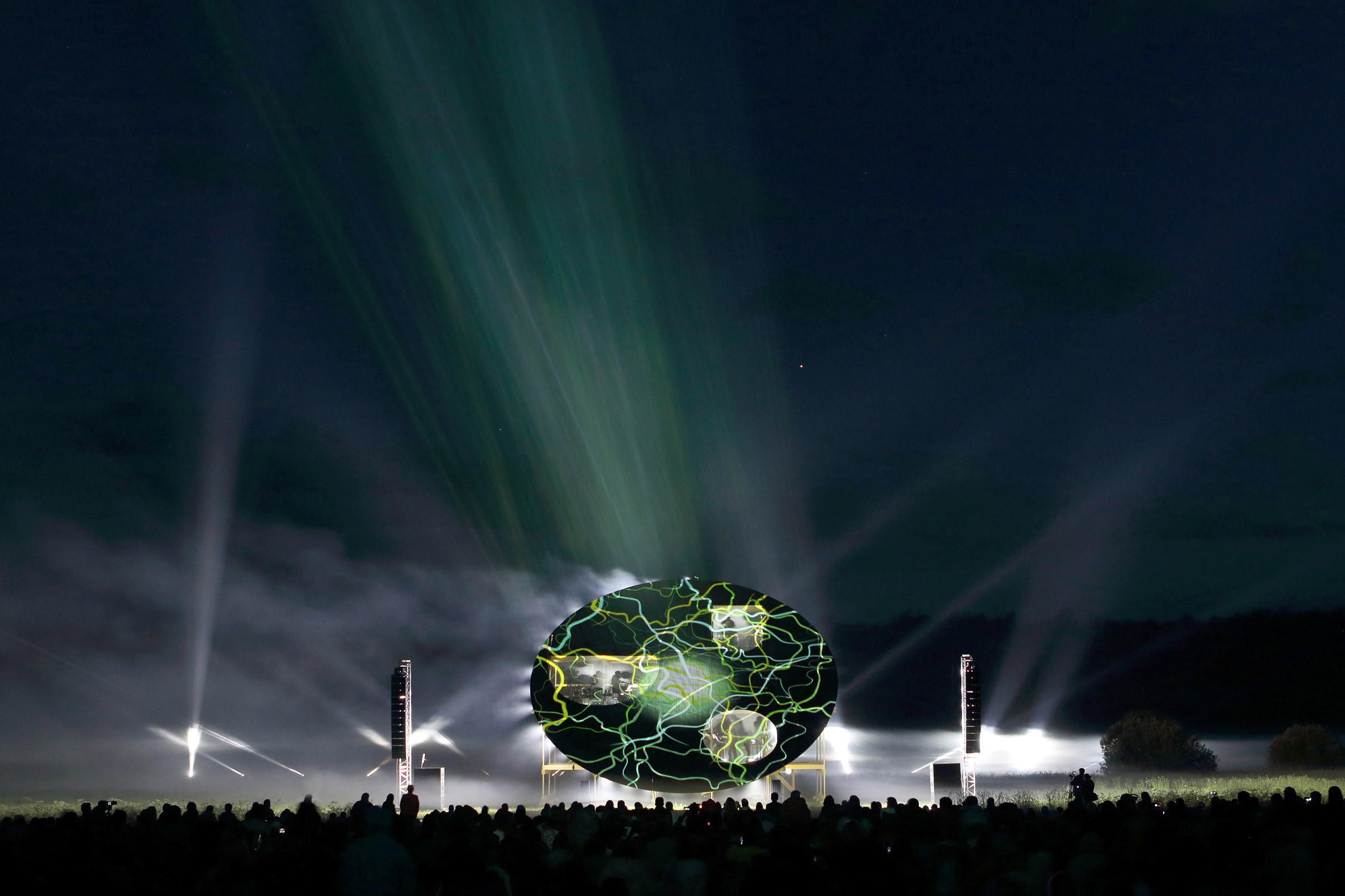 Earthworm-inspired pavilion built in Latvia's floodplains stages concerts and light shows